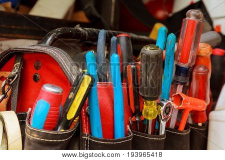 Work Tools In Bag On Wood Background.