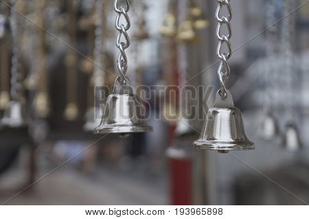 Small bells is gold and silver isolated white background