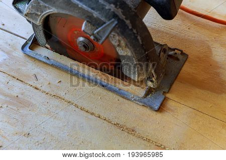 Man Cutting Wood By Machine
