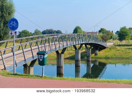 small bicycle and footbridge over a canal