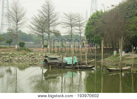 March 17 2017. Guangzhou China. Chinese style boats at the Huangpu Ancient Port scenic area in the city of Guangzhou China in Guangdong province on an overcast day.