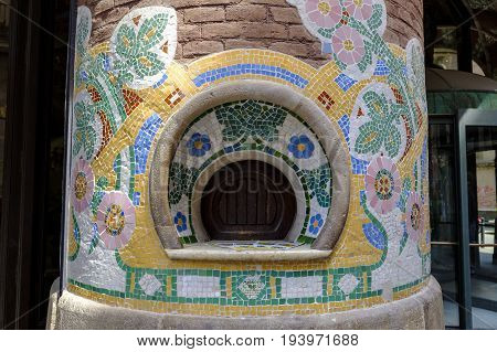 BARCELONA SPAIN - 9 JUNE 2017 - Unusual ticket window on pillar of the Palau de la Musica Catalana music hall decorated with colorful mosaic.