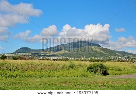 A mountain landscape and sky with white clouds on the island of St. Kitts
