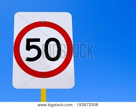 50 speed limit sign on clear blue sky