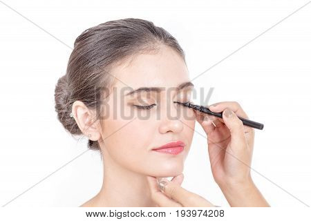 Makeup Artist Applies Brushed At Woman Face. Beautiful Woman Face. Perfect Makeup, Isolated On White