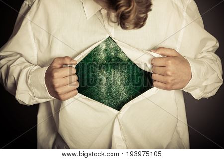 Boy Opening Shirt To Reveal Bizarre Lizard Skin