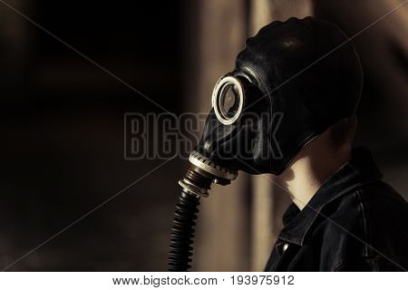 Young Boy Wearing A Vintage Gas Mask