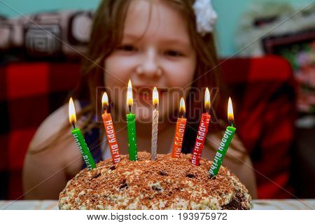 Little Girl Blowing Candles Birthday Cake With Candles