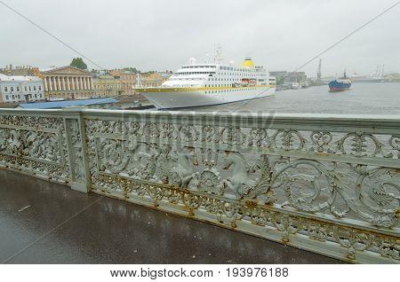 Iron railings on the bridge with mythical horses.
