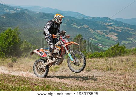 PREDAPPIO, ITALY - JULY 5: biker riding enduro motorcycles KTM 450 EXC in the green hills during the Italian championship Motorally Terre di Romagna, on July 5, 2015 in Predappio, FC, Italy