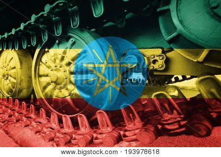 Military Tank Close-up Caterpillar Track With Ethiopia Flag Background.