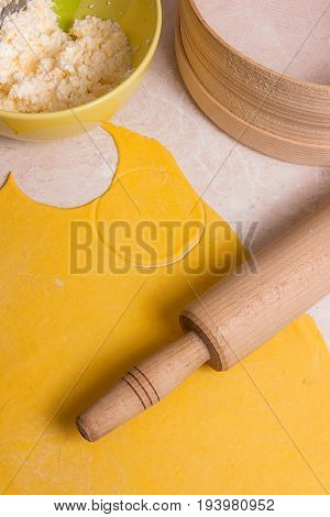 Rolling Pin, Sieve And Rolled Out Dough And Green Bowl With Cottage Cheese Or Curd On Light Marble B