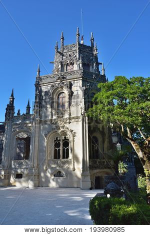 Palace Quinta da Regaleira Sintra Portugal. Palace with symbols related to alchemy Masonry the Knights Templar and the Rosicrucians shown at sunset. Masterpiece of Neo-Manueline architecture style
