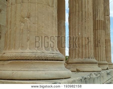 Details of huge Ionic column bases of The Erechtheion, ancient temple on the Acropolis of Athens, Greece