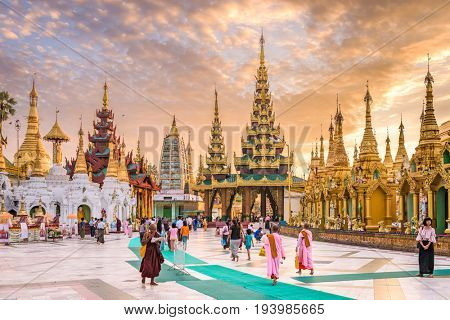 YANGON, MYANMAR - OCTOBER 17, 2015: Early morning worshippers visit Shwedagon Pgoda. Shwedagon Pagoda is the most sacred Buddhist pagoda in Myanmar.