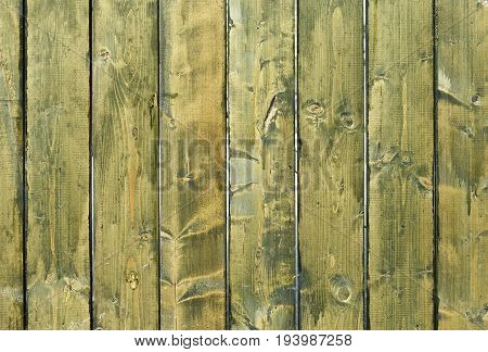 The cracked weathered green and blue painted wooden board texture