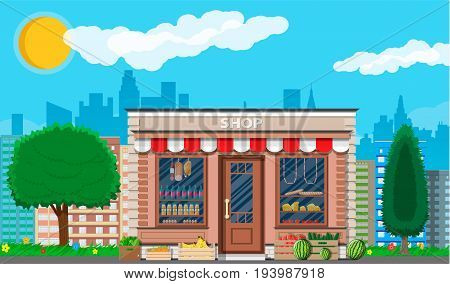 Daily products shop. Local fruit and vegetables store building. Groceries crates in front of storefront. Cityscape, trees, grass, clouds, sun. Vector illustration in flat style