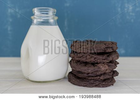 Stack Of Double Chocolate Cookies With White Milk