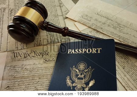 US passport and legal gavel on a copy of the US Constitution