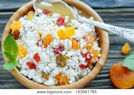 Bowl Of Cottage Cheese, Dried Fruit And Honey Close Up.