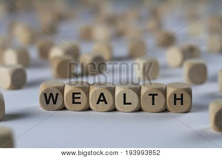 Wealth - Cube With Letters, Sign With Wooden Cubes