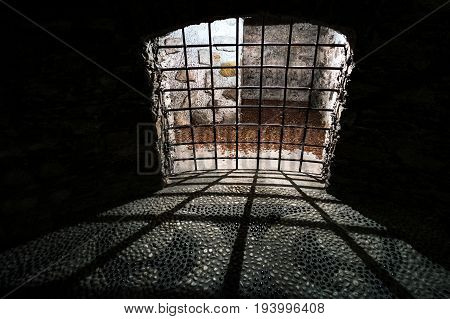 dungeon cell prison bars dark shadow medieval