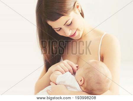 Portrait Happy Smiling Mother Feeding Breast Her Baby At Home In White Room