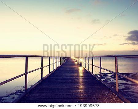 Foot Bridge. Sea Bridge. Slippery Wooden Constrution  Above Sea.