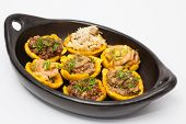 Plantain cups filled with different types of stuffing on black ceramic dish poster