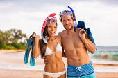 Healthy lifestyle fit body beach snorkel couple with diving masks and fins. Bikini swim models in swimwear snorkeling equipment. Asian girl, caucasian man on summer travel vacations, active lifestyle. poster
