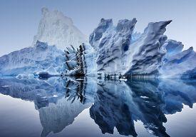 Iceberg Floating In Greenland Fjord