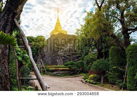 Golden Pagoda Sculpture And Stone Carving At Wat Tham Pha Daen At Sakon Nakhon,thailand.