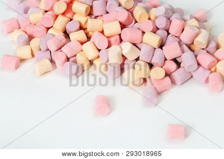 Background From Many Colorful Zephyr. Small Candy Marshmallow Multicolored On White. Sweet Food Fon