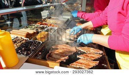 Chef Prepares Grilled Meat For The Village Festival On A Large Fireplace