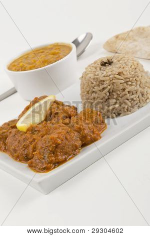 Meat madras served with tarka dahl pilau rice and chapatis. poster