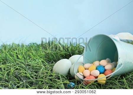 Natural Colored Easeter Eggs And Malt Candy Eggs Spilling From A Robin Egg Blue Metal Basket In The