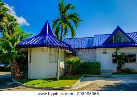 Grand Cayman, Cayman Islands, Nov 2018, Seascape Apartments Building With A Blue Tin Roof