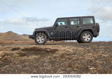 VIK, ICELAND - MAY 03, 2018: Jeep Wrangler Unlimited Sport four wheel drive vehicle being used on terrain driving in Iceland, wild landscape