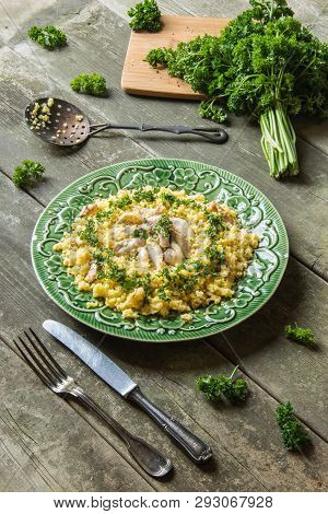 Chicken Couscous Decorated With Fresh Parsley On A Wooden Table Board