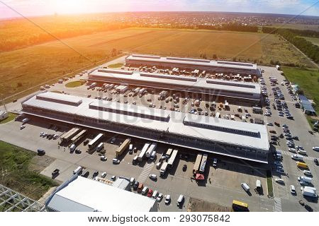 Aerial Drone View Of Group Of Large Modern Industrial Warehouse Or Factory Buildings In Suburban Cit