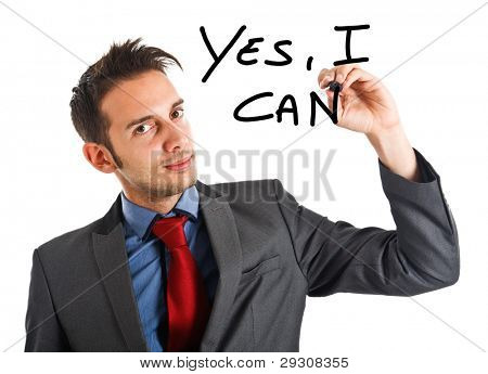 Friendly businessman writing Yes, I can on the screen poster