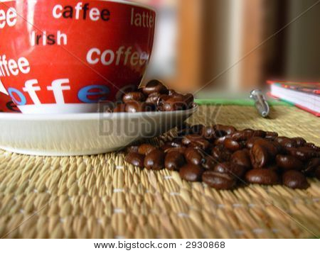 Coffee beans spread on a mat with a