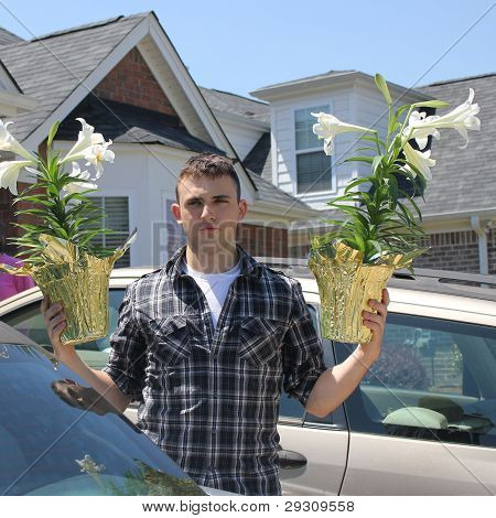 young man holding easter lillies