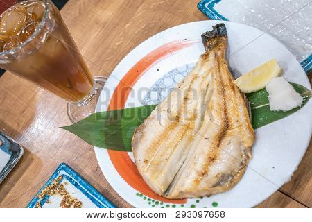 Japanese Cooked Fish In Dish On Wood Table At Japanese Restaurant 24 Hours Open.