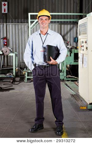 full length portrait of factory technical manager