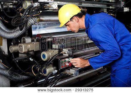 male printer running modern industrial printing machine