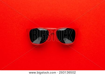 Studio Shot Of Red Sunglasses. Summer Concept With Sunglasses. Minimalist Photo Of Red Sunglasses. T