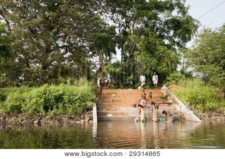 Asian Traditional Hand-washing In A Lake