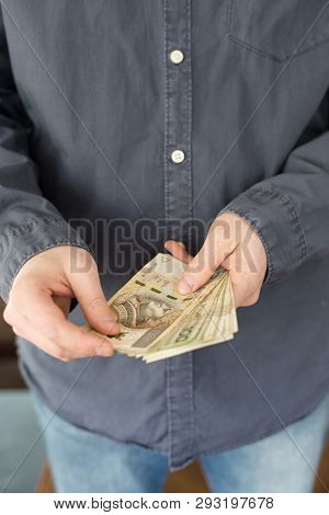 Unemployed Man Counting Money From Polish Social Benefits.