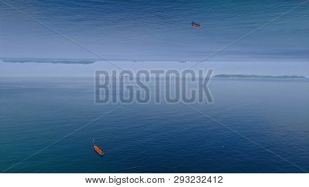 Clear Blue Sea Surface With Ripples And Lonely Red Boat, Mirror Horizon Effect. Media. Beautiful Cal
